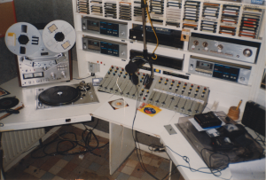 Studio 2 before the reconstruction commences, with (left to right) non-stop tape recorder, record player, cassette players, commercials automation control, clock, telephone fork, CD players, amplifier, mixer, MiniDisc players